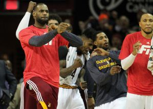 LeBron reacts to Kyrie's three-pointer